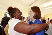 Pres. Sheryl Wilson (left) greets an old friend