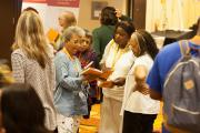 2017 Conference Attendees discussing the Program