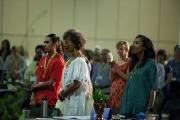 Fania Davis, Teiahsha Bankhead, Terrell Catt and others stand to participate in a Pomo cultural performance