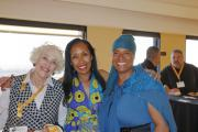 Teiahsha Bankhead (center) with CamishaFatimah Gentry (right) and local team member