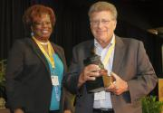 Ted Wachtel receives the Lifetime Achievement Award from Pres. Wilson