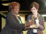 Dr. Marilyn Armour receives Research-Journalism Award from Pres. Wilson