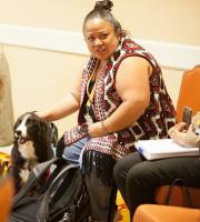 Aouie Rubio with Therapy Dog at the Paws for Peace Session