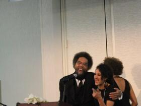 After being Introduced by Fania Davis, Dr. West hugs vocalist Naima Shalhoub
