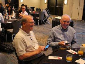 John Sage (right) and Jack Brady (left) Checking Email at Breakfast