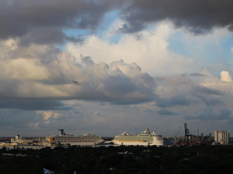 Cruise Ships at Dock and Airliner leaving the Airport