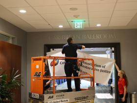 Hotel Staff Installing one of the NACRJ Banners