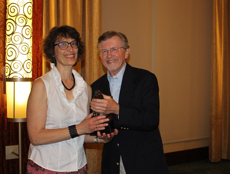 IMG 2029 Nancy Riestenberg receives the John Byrd Award for Education and Teaching from Pres. Mark Umbreit